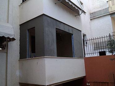 Κλείσιμο  εξωτερικού χώρου με τσιμεντοσανιδες σε οικια στον Γερακα