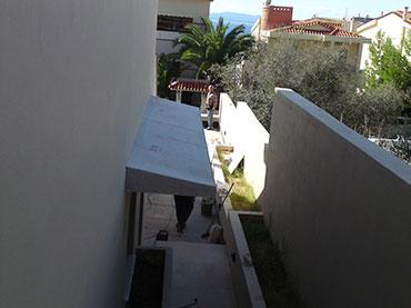 Σκέπαστρο σε οικία στη Βούλα με τσιμεντοσανίδα